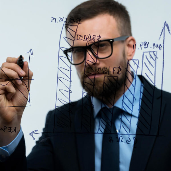 man-draws-various-growth-charts-calculating